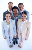 Happy multi-ethnic business team smiling at the camera — Stock Photo