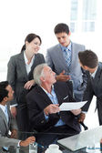 Multi-ethnic business discussing a contract — Stock Photo