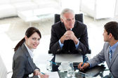 Businesswoman sitting at a conference table — Stock Photo