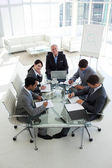 High angle of a business team sitting around a conference table — Stock Photo