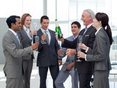 Smiling business celebrating a success — Stock Photo