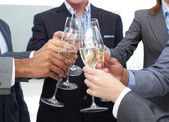 Close-up of business team toasting with Champagne — Photo
