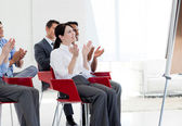 Multi-ethnic business clapping at the end of a conference — Stock Photo