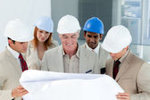 A group of architect discussing a project — Stock Photo