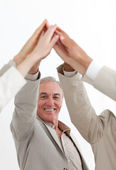 Smiling businessman joining hands with his team — Stock Photo