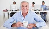 Senior businessman drinking a coffee — Stock Photo