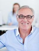 Senior manager wearing glasses — Stock Photo