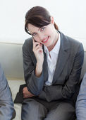 Businesswoman on phone sitting in a waiting room — Stock Photo