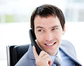Assertive young businessman talking on phone — Stock Photo