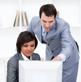 Two confident business partners working at a computer — Stock Photo