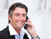 Handsome mature businessman talking on phone — Stock Photo