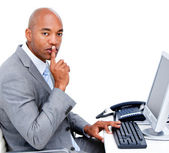 Confident businessman asking for silence sitting at his desk — Foto Stock