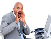 Afro-american businessman yelling sitting at his desk — Stock Photo