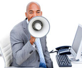 Stressed businessman yelling through a megaphone — Stock Photo
