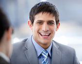 Positive businessman in a meeting — Stock Photo