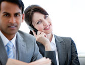 Confident businesswoman on phone sitting on a sofa — Stock Photo