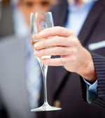 Close-up of a businessman holding a glass of Champagne — Stock Photo