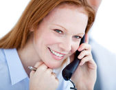 Positive businesswoman taling on phone — Stock Photo
