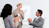 Smiling business applauding a good presentation — Stock Photo