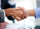 Close-up of business partners shaking hands — Stock Photo