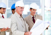 Architect team working on a building project — Stock Photo