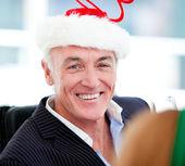 Mature businessman celebrating christmas — Stock Photo