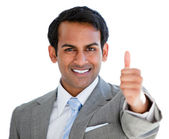 Positive businessman with a thumb-up sign — Stock Photo