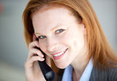 Self-assured business woman taking a call — Stock Photo