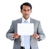 Confident businessman showing a note — Stock Photo