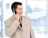 Charming businessman talking on phone standing — Stock Photo