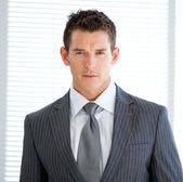 Portrait of a charismatic businessman standng — Stock Photo