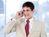 Laghing businessman talking on phone standing — Stock Photo