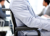Close-up of a businessman sitting on a wheelchair — Stock Photo