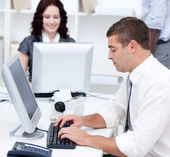 Assertive young business working at computers — Stock Photo