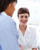 Attractive businesswoman smiling at the camera — Stock Photo