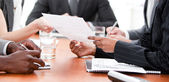 Close-up of multi-ethnic business in a meeting — Stock Photo