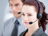 Assertive customer service representatives standing in a line — Stock Photo
