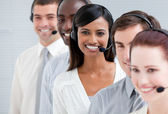 Multi-ethnic customer service representatives standing in a line — Stock Photo