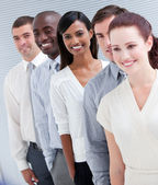 Cheerful multi-ethnic business partners standing in a line — Stock Photo