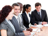 Assertive multi-ethnic business in a meeting — Stock Photo