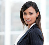 Portrait of a charismatic businesswoman standing — Stock Photo