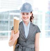 Portrait of a self-assured female architect holding blueprints — Stock Photo