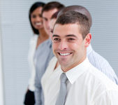 Positive business partners standing in a line — Stock Photo