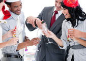 Business team drinking champagne to celebrate christmas — Stock Photo