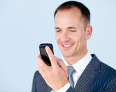 Self-assured businessman sending a text with his phone — Stock Photo