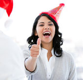 Positive businesswoman doing a thumb-up to celebrate christmas — Stock Photo