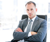 Confident businessman looking at the camera sitting — Stock Photo