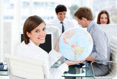 Confident businesswoman holding a globe — Stock Photo