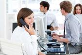 Enthousiastic businesswoman talking to the phone — Stock Photo