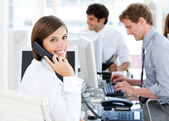 Smiling businesswoman talking to the phone — Stock Photo
